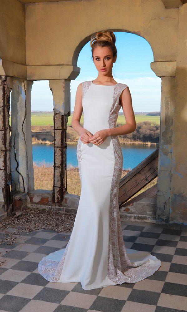 Clara rochie de mireasa tip sirena, realizata din crep si dantela de bumbac. acest model confera iluzia de transparenta